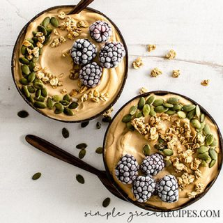 Close up of the Easy Peanut Butter and Banana Smoothie Bowls on a photography backdrop.