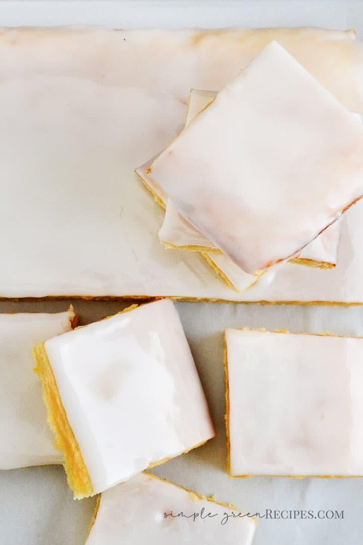 overhead shot of the Vegan Gluten Free Lemon Cake, sliced and glazed.