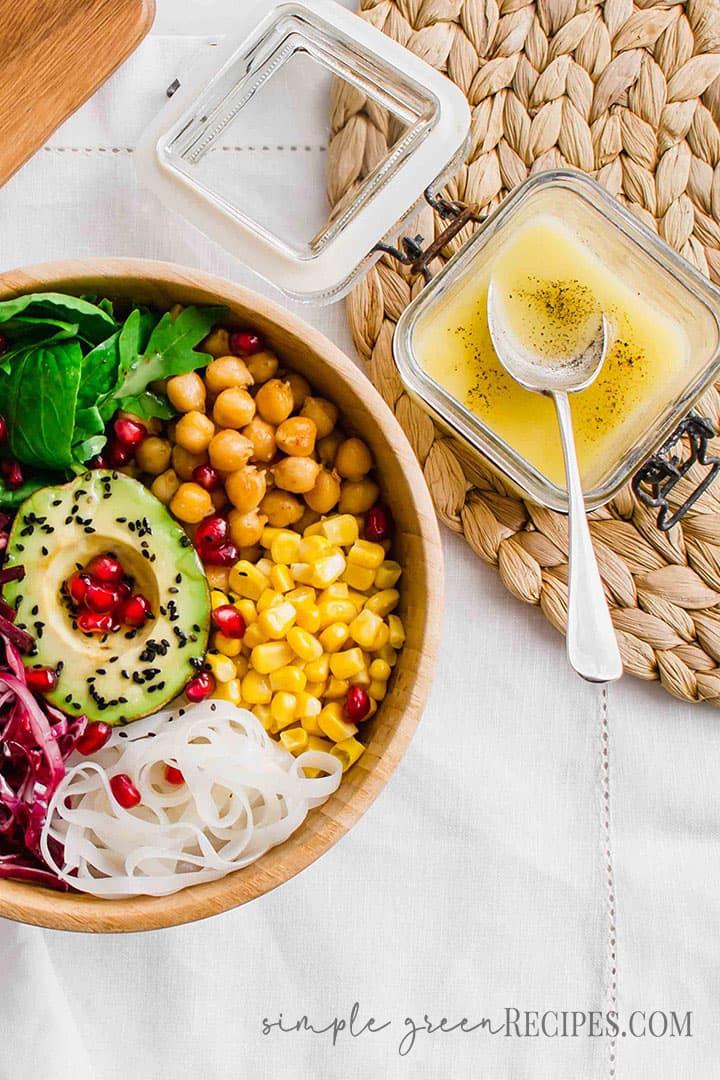 Eye-level of the Vegan Buddha Bowl and the Lemon Vinaigrette dressing.