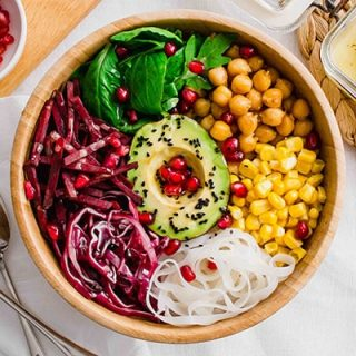 Overhead shot of the Vegan Buddha Bowl with legumes, noodles, fresh veggies and avocado.