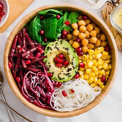 Overhead shot of the Vegan Buddha Bowl with legumes, noodles, fresh veggies and avocado.