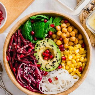 Overhead shot of the Vegan and Gluten-free Buddha Bowl, topped with pomegranate seeds.