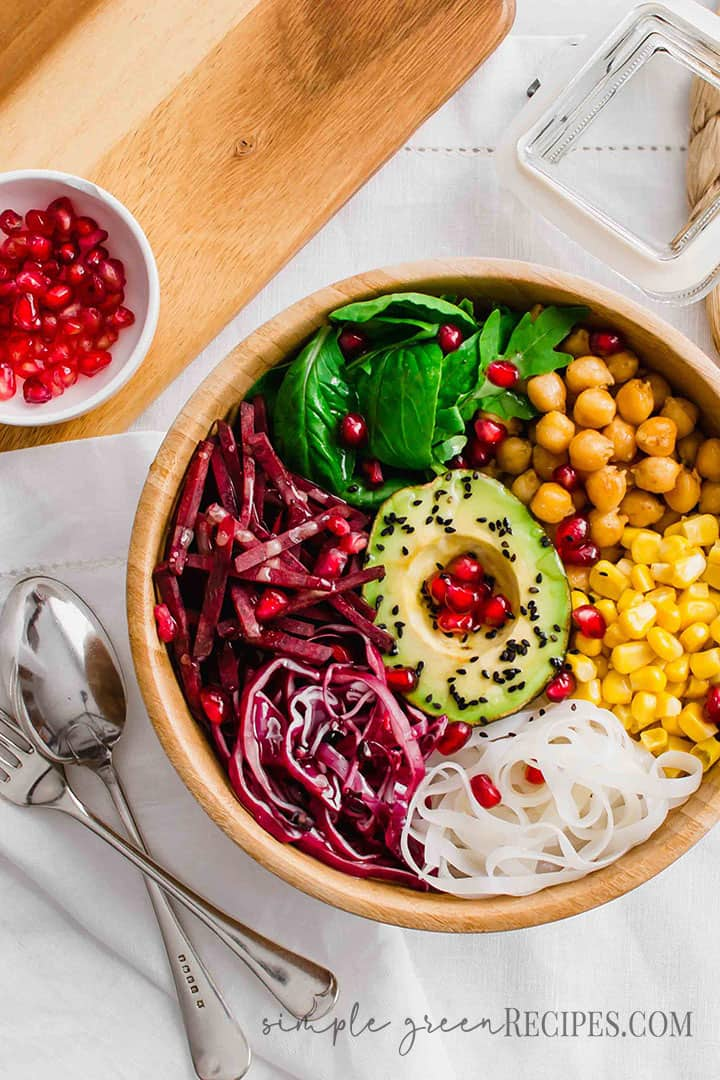Vegan and vegetarian Buddha Bowl with pomegranate topping.