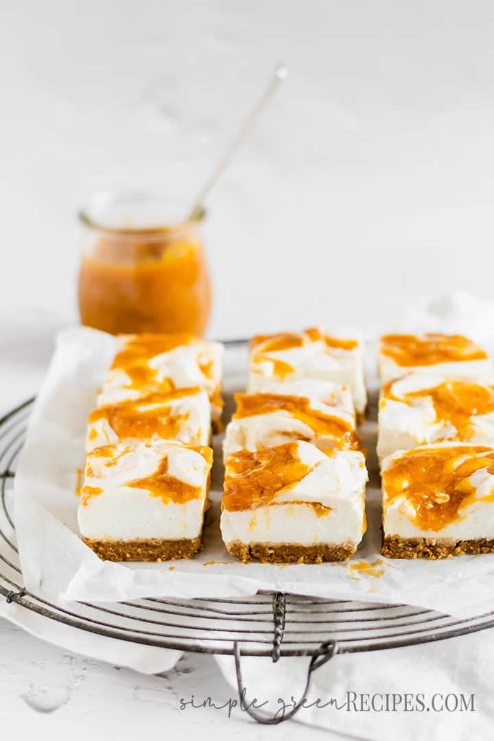 High angle shot of Healthy Peach Cheesecake Bars topped with peach jam