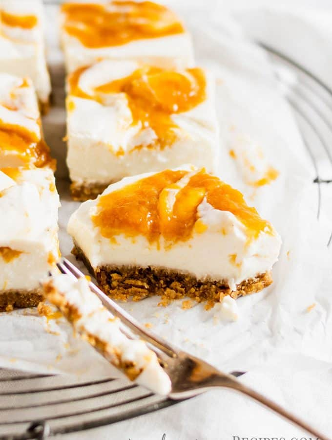 Close up of a bitten bar of the No Bake Vegan Peach Cheesecake