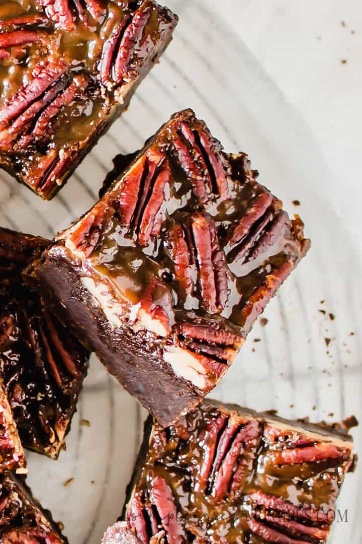 Over head shot of a chocolate brownie topped with pecan pie.