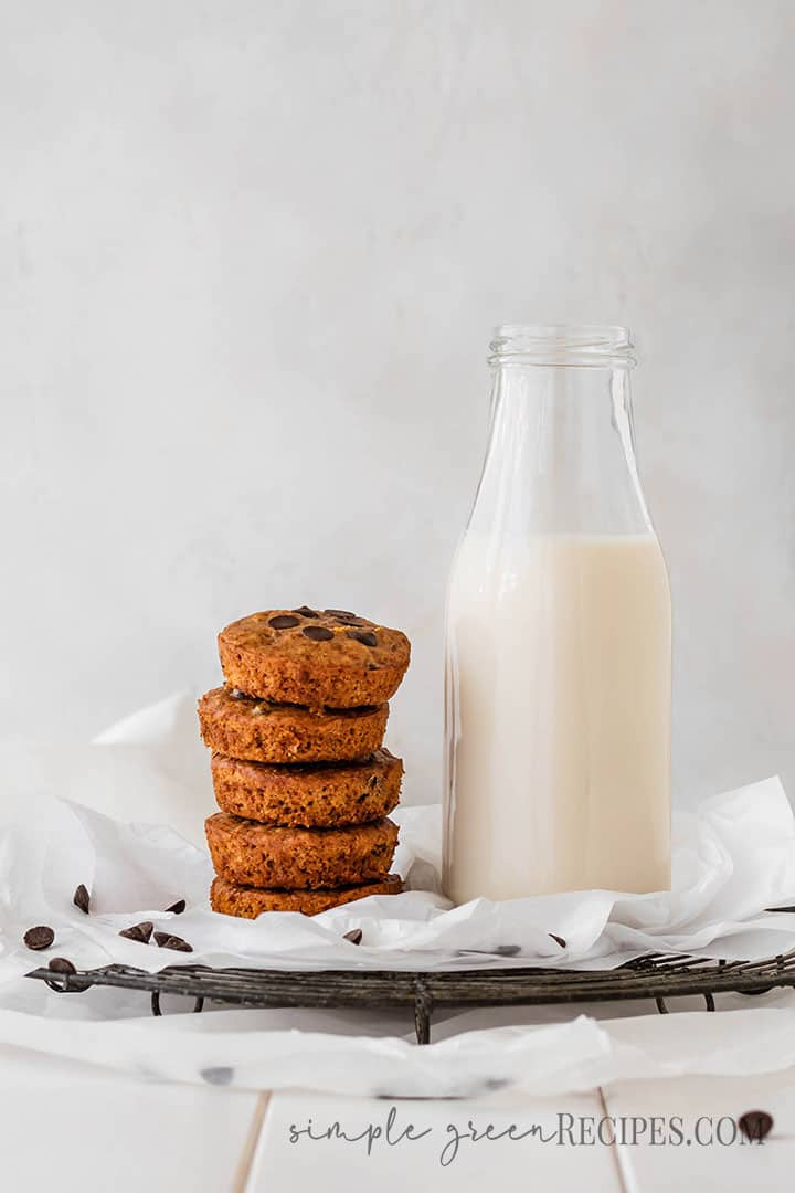 Eye level shot of a stack cookies next to a bottle of milk.