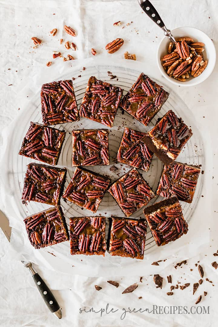 Over head shot of the sliced brownies and a bowl of pecans.
