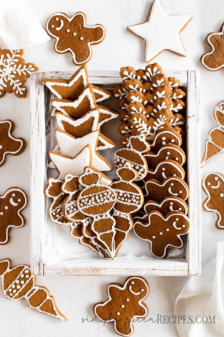 Over head shot of the Vegan Gingerbread Cookies placed on a white wooden tray.