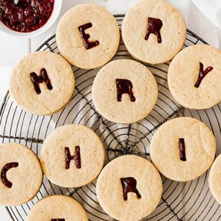 Alphabet linzer cookies filled with raspberry jam