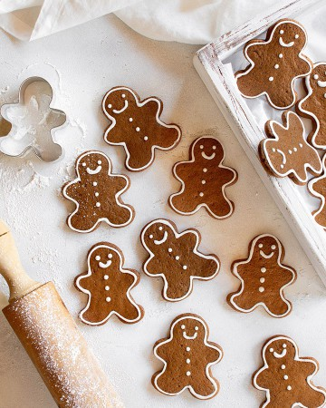 Over head shot of the gingerbread man cookies on a white surface.