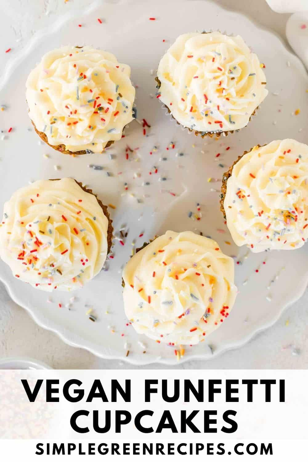 Cupcakes frosted with vanilla buttercream and topped with colourful sprinkles on a white ceramic base