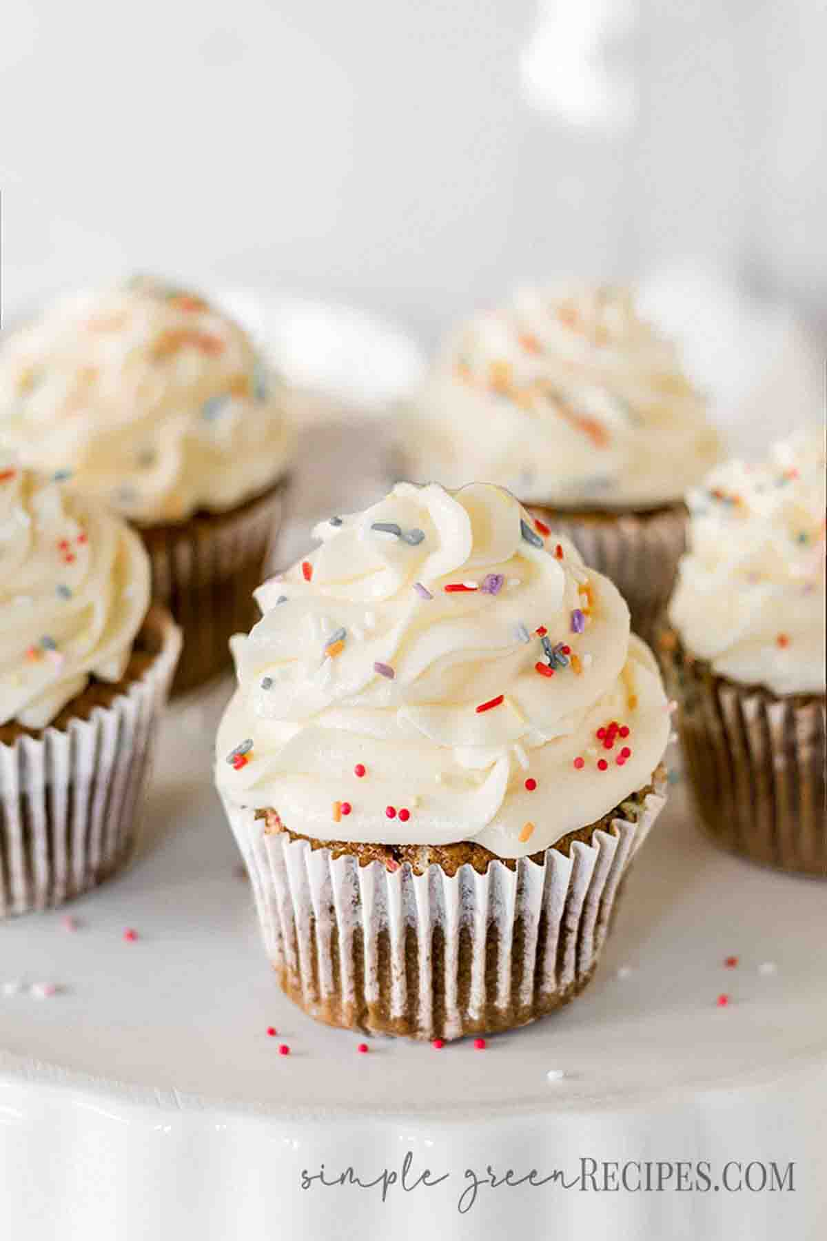 Cupcakes frosted with vanilla buttercream and topped with colourful sprinkles