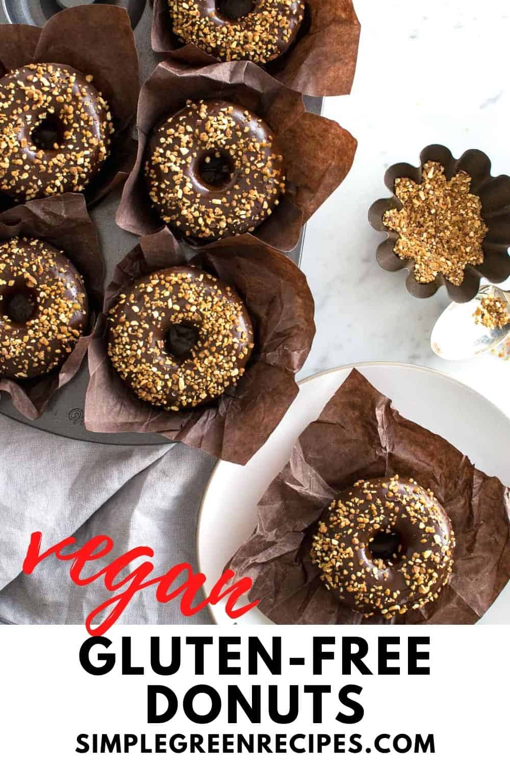 6 donuts frosted with glaze chocolate and crunchy almonds, on a brown muffin paper
