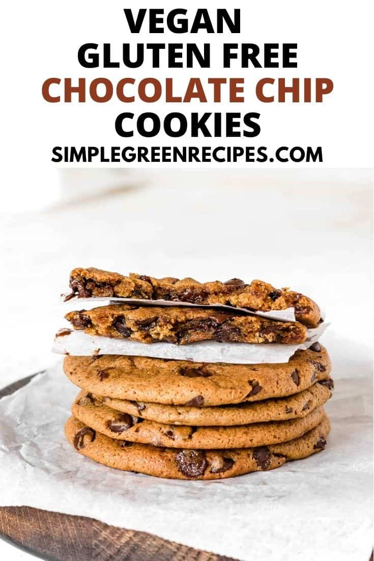 Stack of chocolate chip cookies on a parchment paper, with a cookie on top split in two