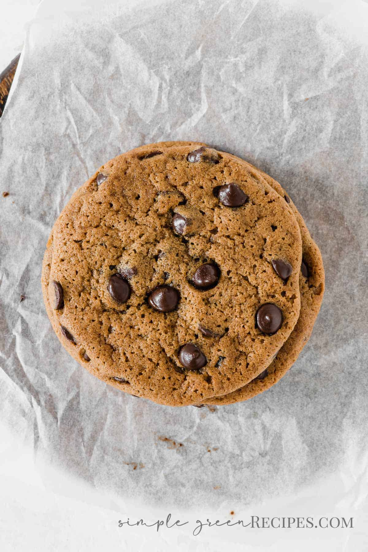 Stack of chocolate chip cookies on a parchment paper