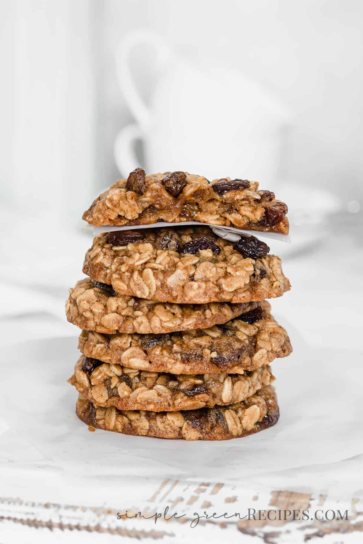Stack of oatmeal raisin cookies on a parchment paper