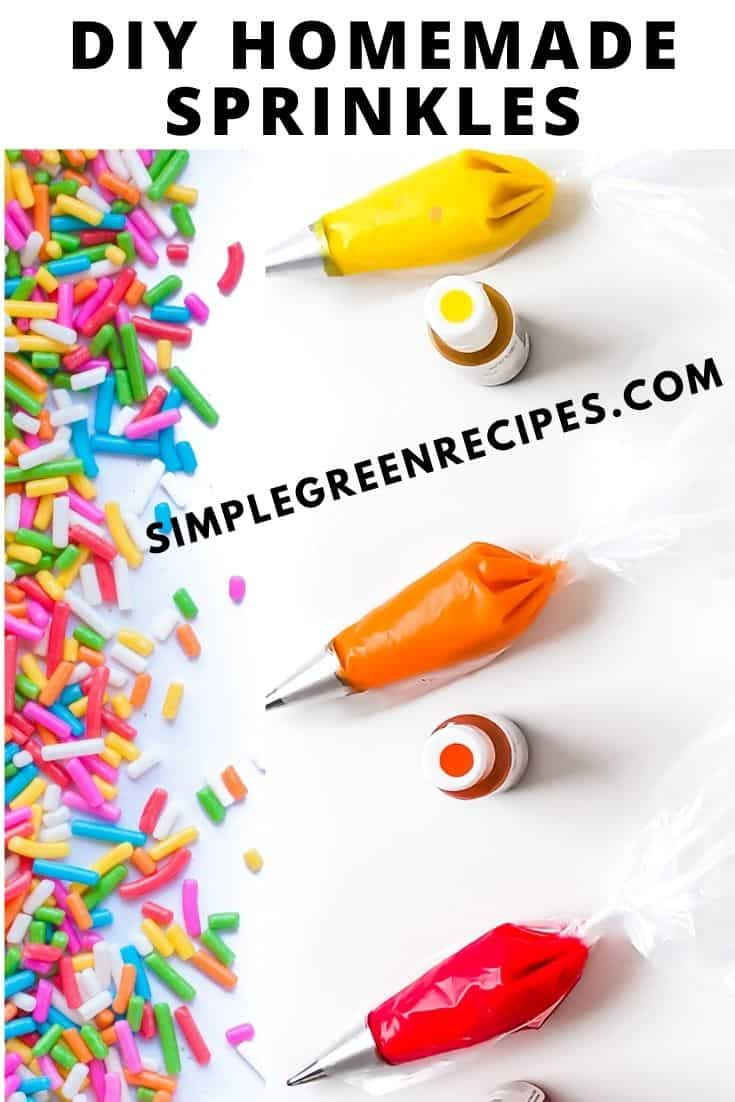 Three piping bags fitted with piping tips and filled with red, orange and yellow icing, and three bottles of food coloring. And finished sprinkles.