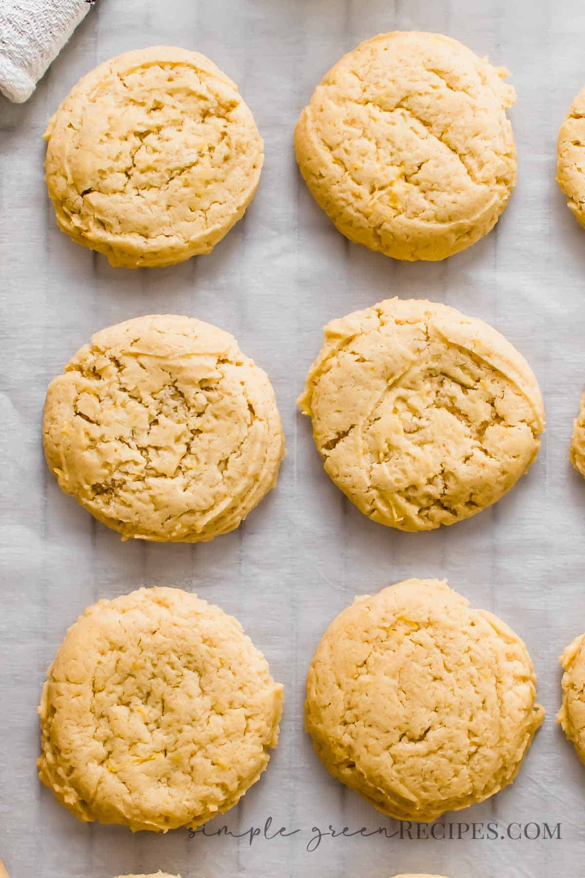 Cookies on a parchment paper over a cooling rack.